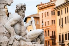Statue of the god Zeus in Bernini`s Fountain in the Piazza Navona, Rome Stock Image