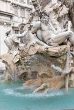 Statue of the god Zeus in Fountain of the Four Rivers in Piazza Royalty Free Stock Images