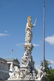 Statue of Goddes Athena in Front of the Austrian Parliament. Statue of Goddes Athena, standing on a pillar, symbolizes the wisdom Stock Photo