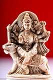 Statue of Goddess Durga. Isolated on red background stock photography