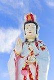 Statue of Godness Guan Yin. In Thailand with blue sky background Stock Images
