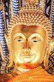 A statue of Gold Buddha in Wat Po. Bangkok, Thailand Stock Photos
