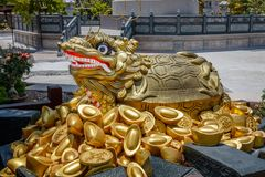 Statue of gold coins and a turtle at Kuang Im Chapel near River Kwai, Kanchanaburi, Thailand. Statue of gold coins and a turtle at Kuang Im Chapel near River Royalty Free Stock Image