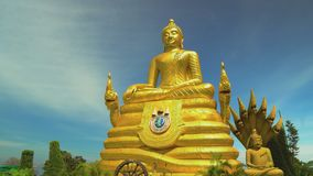 A statue of a golden buddha. Asian religious shrine, travel and tourism. Buddhism. A statue of a golden buddha. Asian religious shrine, travel and tourism stock footage