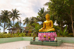 Statue of golden Buddha in Thailand Royalty Free Stock Image