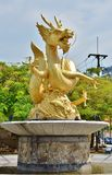 Statue of golden dragon in the Queen Sirikit Public Park in Phuket Stock Images