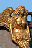 Statue of golden woman. St.Petersburg , Russia Royalty Free Stock Images