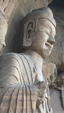 Statue at the Gongyi Caves. Buddhist caves at Gongyi have some greater than life size statues Royalty Free Stock Photography