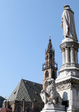 Statue and gothic parish church in Bolzano, Italy Stock Photography