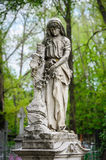 Statue on the grave Royalty Free Stock Image