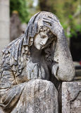 Statue on grave in the old cemetery Stock Photography