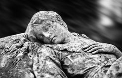 Statue on grave in the old cemetery Royalty Free Stock Image