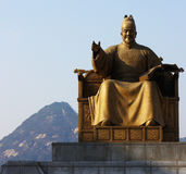 Statue of Great King Sejong in Gwanghwamun. Statue of Great King Sejong on Sejong-daero in Gwanghwamun neighborhood of Seoul, South Korea, against a mountainous Stock Photos