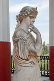 Statue of a Greek muse in Achilleion Corfu, Greece. Statue of a Greek mythical muse in the balcony of Achilleion palace in Corfu, Greece Stock Photos
