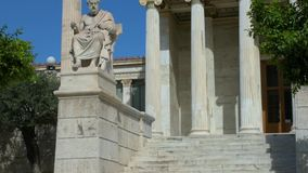 Statue of the Greek philosopher Platon. Tilting view of the statue of the Greek philosopher Platon in front of the National Academy of Athens, Greece stock video footage