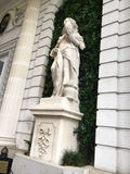Statue on Green. A statue at the entrance of an ornate building in New Orleans, Louisiana Stock Image