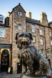 A statue of Greyfriars Bobby in Edinburgh. EDINBURGH, SCOTLAND -DEC 10: A statue of Greyfriars Bobby in Edinburgh on December 10, 2015. Bobby was a dog who Stock Image