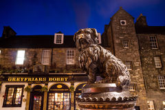 A statue of Greyfriars Bobby in Edinburgh. EDINBURGH, SCOTLAND -DEC 10: A statue of Greyfriars Bobby in Edinburgh on December 10, 2015. Bobby was a dog who stock photography