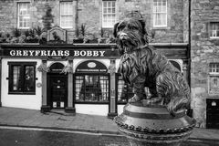 A statue of Greyfriars Bobby in Edinburgh. EDINBURGH, SCOTLAND -DEC 10: A statue of Greyfriars Bobby in Edinburgh on December 10, 2015. Bobby was a dog who Stock Images