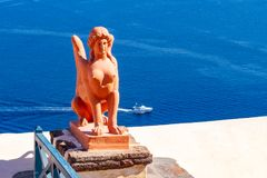 Statue of a Griek Sfinx in Oia town Santorini Greece-2 royalty free stock images