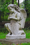 Statue of grieving angel in Nikolsky cemetery in Alexander Nevsky Lavra in Saint Petersburg, Russia Stock Image