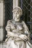 Statue of a grieving girl stock image