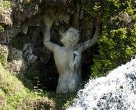 Statue in a grotto. In the garden of Villa d'Este, Tivoli, Italy royalty free stock photography