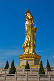 Statue of Guanyin. Large golden statue or monument of Guanyin, an empress of the Chen Dynasty who became a Buddhist nun Royalty Free Stock Image