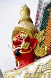 Statue of a guardian at Thai temple. Huge statue representing a giant with big teeth supposed to frighten the spirits or demons who would like to enter Buddhist Stock Images