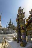Statue guarding temple. At Wat Phra Kaeo Royalty Free Stock Photos