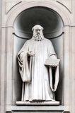 Statue of Guido d'Arezzo in Uffizi Alley in Florence, Italy Stock Photos