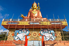 Statue of Guru Rinpoche, the patron saint of Sikkim that view at the base from front and  below with construction site. Stock Images