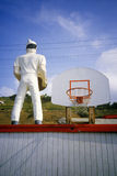 Statue of hamburger chef with Basketball goal in background, Malibu, CA Royalty Free Stock Photo