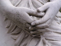 Statue Hands. Hands on a statue in a cemetery Stock Images