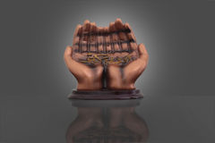 Statue of hands with Allah scripting Stock Image