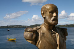 Statue in the harbour of Chiloe. Statue of Arturo Prat, the favourite Chilean national hero, in the harbour of Chonchi, Chiloe island. Arturo Prat was a captain Royalty Free Stock Image