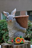Statue of a hare carrying the basket Royalty Free Stock Photo