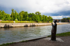 Statue of Harmony before heavy storm  on the Vltava river banks. Stock Photos