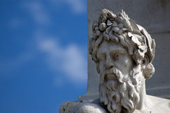 Statue head. A marble head and a blue sky on background Royalty Free Stock Image