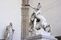 Statue of Hercules, Loggia dei Lanzi, Florence, Italy. Statue of Hercules killing the Centaur, by Giambologna. Displayed in the open-air gallery Loggia dei Lanzi Royalty Free Stock Images