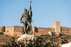 The statue of Hernan Cortes with castle of Medellin in the background, Extremadura, Spain stock image