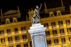 Statue of a hero at night decorated Christmas (Santander, Spain) Royalty Free Stock Images