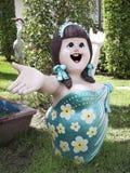 Statue heureuse de fille Photographie stock
