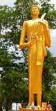A statue of hiking monk carrying Stock Image