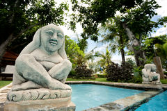 Statue of Hindu deity overlooks pool Royalty Free Stock Image