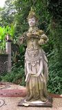 Statue of Hindu God on Bali Island. Hindu God in the royal garden of Tirta Gannga. A statue on a white stone pedestal. royalty free stock photography