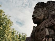 Statue of Hindu god in Bali temple stock photos
