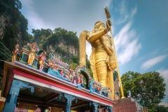 Statue of hindu god Muragan at Batu caves. The Batu Caves and temple with statue of hindu god Murugan at entrance near Kuala Lumpur Malaysia Stock Image