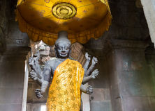 A statue of the Hindu god Vishnu atAngkor Wat, Cambodia. Stock Photography