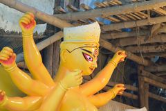Statue of Hindu Goddess Durga under preparation for Durga Puja festivals. Clay idol of Goddess Durga, under preparation for Bengal`s Durga Puja festival in Stock Photography